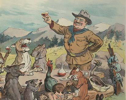 Political cartoon from Puck magazine.   Illustration shows Theodore Roosevelt, wearing his rough rider uniform, sharing a feast with many wild animals sitting around a large banquet table in the wilderness.