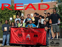 Photo of the Native American Student Association (NASA) with books for READ poster.