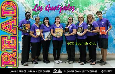 Los Quetzales Spanish Club holding books of thier interest.