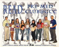 Pre-Med Club holding books of thier interest.