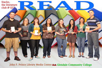 Photo of STACKZ Literature Club students holding books for READ poster.